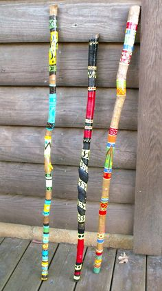 """Painted Walking Sticks"" Beplak je wandelstok met washi tape buy at www. Wooden Walking Sticks, Walking Sticks And Canes, Walking Canes, Painted Driftwood, Driftwood Art, Painted Bamboo, Spirit Sticks, Stick Art, Painted Sticks"