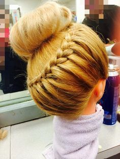 Get hot styles to help keep you cool this summer.  This braided bun was created by students at our beauty school in North Austin!  For more pictures check out www.Facebook.com/BellaBeautyCollege
