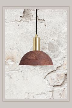 This hand carfted ceramic pendant light is a charming light fixture that is full of character. The organic rustic pendant light is made from sustainable and natural materials. #pendantlighting #ceramiclighting #ceramicpendants #rusticceramics #ceramics #potteryproducts #uniquelighting #rusticlighting #Lightingdesign