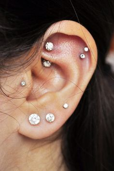 tragus, rook, double helix and triple lobe piercings