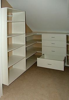 Maximize your tight hidden spaces! L-shaped shelves allow easy access to corner areas in this attic walk- Maximize your tight hidden spaces! L-shaped shelves allow easy access to corner areas in this attic walk-in closet. Attic Bedroom Closets, Attic Closet, Attic Rooms, Attic Spaces, Walk In Closet, Closet Small, Garage Attic, Attic Playroom, Attic Apartment