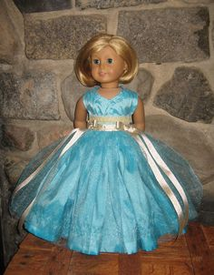 Aqua princess dress with shimmery tulle skirt and gold embellishments