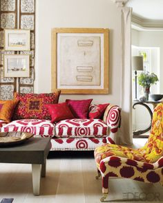 The custom-designed sofa and chair in a London drawing room are upholstered in fabrics by Penny Morrison and Robert Kime, respectively.