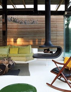 modern cabin lounge living room --- I can't see having white flooring around a fireplace but you know...