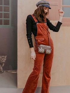 a70141c14fa3 Burnt orange overalls with a black blouse and tan caddy hat. Visit Daily  Dress Me
