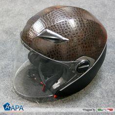 Motorcycle Helmet wrapped with brown leather and black carbon 3D #apastickers #apafilms #apafolie #apavinyl #wrapping #carbonfoil #carbonfolie #pellicolacarbonio #selfadhesive #carbonblack #carbonlook #leather #brownleather #helmetwrap #carbonhelmet