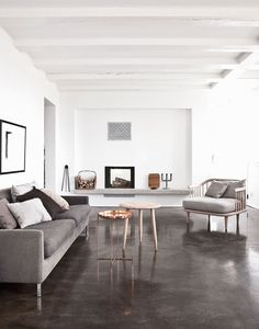 Sleek dark gray concrete floors and basic furnishings in this apartment near Copenhagen. Styled by Pernille Vest and shot by Jonas Bjerre-Poulsen for Elle Decoration - Polished Concrete Living Room Flooring, Basement Flooring, Flooring Ideas, Basement Walls, Kitchen Flooring, Kitchen Cabinets, Elle Decor, Ikea Sofas, Painted Concrete Floors
