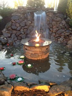 Allen Roth Fire Table Placed In A Small Water Feature Give A Cool Affect Of  Fire