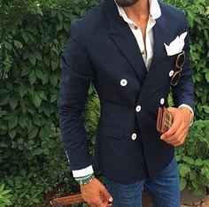 Navy blazer w/ white buttons.