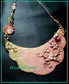 copper repousse and clay necklace