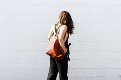 Posse Isobel Jumpsuit, Kristiina Taylor Tote Bag, and Marais X FLL Slides.