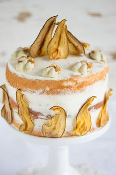 pear liqueur cake with pear chips and chocOlate-coated walnuts
