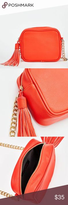 """🎉Host Pick🎉JustFab Otto JustFab Otto in red color. Swing into spring with this fabulous fringe tassel bag. It features a zip around closure and chain shoulder strap. You'll wear this baby with everything! Material: Faux Leather. Size: 8.5L x 7H x 3D. Hardware color: Gold. Shoulder drop measurement : 21"""". Pockets: 1 interior pocket, 1 interior zip. Closure: Zip closure. Imported. New with tags, unused. HOST PICK - 9/5/16. JustFab Bags Crossbody Bags"""