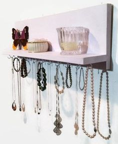 The Renewed Decor Necklace Rack and Shelf is a painted pine wall mount long necklace holder and jewelry organizer that was specifically designed to organize necklaces, link type bracelets even hook da