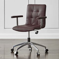 Shop Navigator Saddle Brown Leather Office Chair.   Five-star base swivels 360 degrees and rolls on black plastic casters.  The Navigator Leather Office Chair is a Crate and Barrel exclusive.
