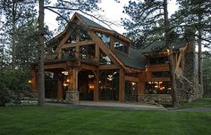 Modern Timber Frame! Love the balcony over the port-cochere and the triangle windows in the end walls of the dormer!!