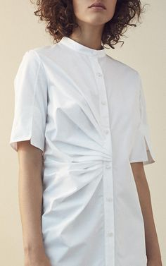 This **Nellie Partow** shirt dress features short sleeves and a pleated detail at the waist.