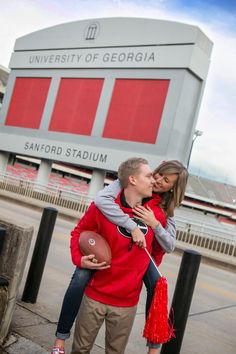 Athens engagement session on UGA's campus and by Sanford Stadium. Fun Georgia-themed shoot. By wedding & engagement photographer: Claire Diana Photography #athens #uga