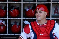 Chris Iannetta cracks a smile in the dugout during the Angels – Houston game