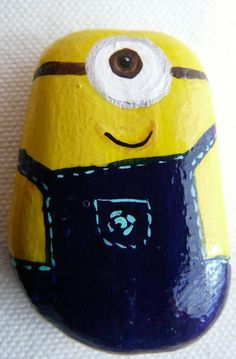 Adorable Bright Yellow Hand Painted Rock Minion! He is Wearing a Dark Blue Jumper.