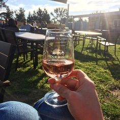 """""""Sunshine and rosé at @fourwindsvineyard; what a perfect Sunday afternoon."""" @canberra.life recently visited the Four Winds Cellar Door for a wine tasting, but the vineyard is also known for delicious wood fired pizzas, including potato and gorgonzola and a vegetarian special. #visitcanberra #onegoodthingafteranother"""