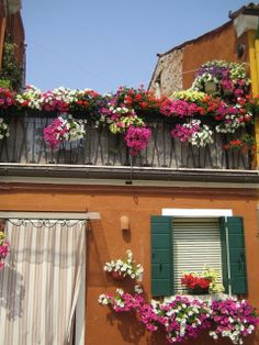 Gorgeous window boxes in Burano, Italy | Flickr - Alex ᘡղbᘠ