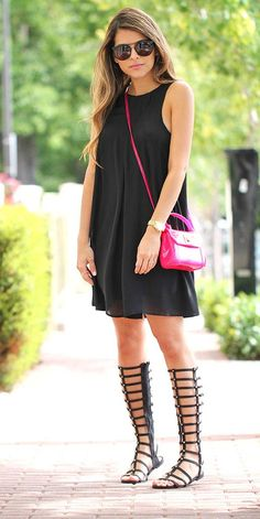 A cute summertime date night outfit: an LBD and knee-high gladiator sandals