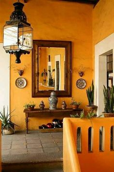 Tuscan Orange Wall Living Room With Dark Wood Details
