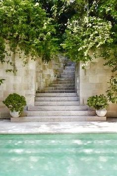 Love the tranquil feel of these garden steps to the pool.