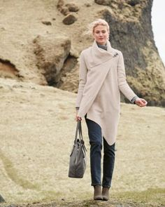 Our favorite asymmetric coat wakes up winter togs. The flirty shape is the same: A-line silhouette, dramatically draped collar, and striking angled raw hem. We doubled the wool for a nice drape, and added a brushed-metal clasp for a little edge.