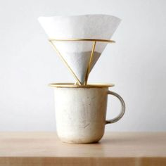 The Minimalist Coffee Dripper is a perfect tool for busy mornings. Its wire-like design allows the coffee filter to fit without it sticking. It is an aesthetically pleasing item that will make a great addition to your kitchen.