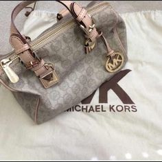 Authentic mk bag!:) only want to trade! Will trade for another mk:) really only want to trade for another mk bag or an mk backpack!:) the mini ones! If someone wants to trade for the xs mk backpack I will throw in a free! Mk wallet!:) Michael Kors Bags