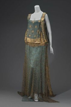 Evening Gown, 1920s, via The Museum of Fine Arts, Boston. Made in part from an Indian sari of blue and gold; straight cut; blue satin slip; front of bodice and back, including short train, of sari; skirt of dress and underarm panels of gold lace; worn by Mrs. John D. Rockefeller, Jr.. silk, gold thread.