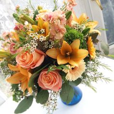 Peach Flower Arrangement, lilies, roses, and gerbers