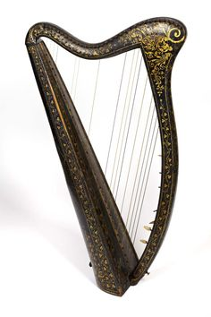 """""""The Egan harp"""" -- An Irish harp, instrument from medieval times that was dying out around 1800, made by John Egan, considered by many as the father of the modern Irish harp. (http://en.wikipedia.org/wiki/John_Egan_%28harp_maker%29) Photo and harp are from the National Museum of Ireland."""