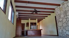 Wooden beams and ceiling fans. Hacienda del Rio, Custom retirement homes. Playa del Carmen real estate area.