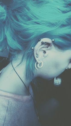 okay so eventually it'd be like this except without the top septum ring and the gauge, or something like that Industrial Bar Piercing, Industrial Jewelry, Industrial Bars, Blue Green Hair, Pink Hair, Cool Piercings, Cartilage Piercings, Multiple Ear Piercings, Hair Color And Cut
