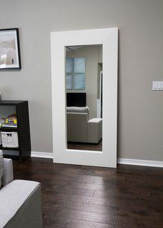Grey Wall, White Base Boards, Dark Hand Scraped Wood Floors