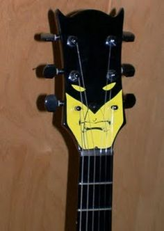 batman guitar head- that's awesome!  I'd never do it to my guitar, but I may make a guitar for this purpose some day