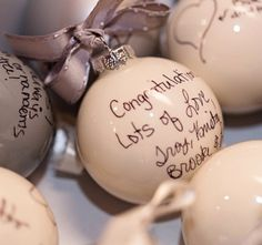 Write notes to your guests on plan ornaments for a creative wedding favor.  You can also have your guests write notes to you on ornaments to fill your first Christmas tree as a couple.