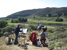 Members of Plein Air Artists of Riverside during a recent paint-out. See which painter received the PleinAir Magazine award at http://www.outdoorpainter.com/awards/pleinair-magazine-award-in-california.html