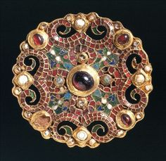 The Dorestad brooch, a Carolingian brooch c.800, makde from gold, glass, enamel, almandines and pearls; symbols include two intersecting Christian crosses and trees of life. (Rijksmuseum van Oudheden, loaned from the province of Zuid-Holland)