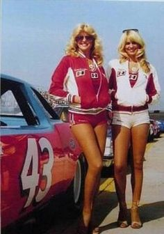 Linda Vaughn and another beautiful Hurst Shifter girl hang out next to Richard Petty's STP Oldsmobile Cutlass.