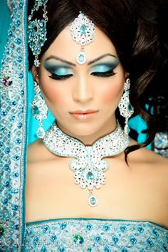 Typical Indian bridal makeup. This shows they use bright colour eyeshadow with minial eyeliner and long lashes. I want one of my characters eyes to remain normal to suggest that my character is indian.