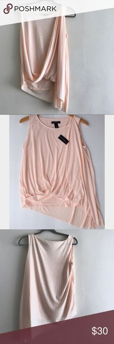 NWOT White House Black Market Tank Top Peach S $68 White House Black Market Slub Drape Front Asymmetrical Tank Top In a peach / pink color. So pretty and delicate looking . Love it! Size small. One of the pictures I got from Pinterest to better show color. :) White House Black Market Tops Tank Tops