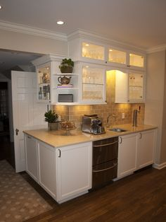 Bar area with double drawer dishwasher, prep sink and refrigerated beer tap.