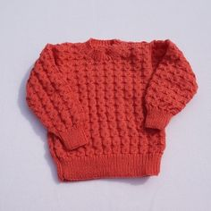 Hand knitted baby girl jumper in deep pink to fit 12-18 months £20.00