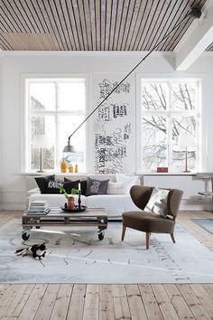 love the chair, floors, calligaphy, high ceilings, the light fixture...