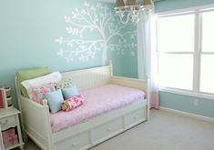 Cute little girls room. Simple with homemade pillows. Love wall color. looks so fresh...could reverse pink and aqua