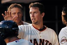 San Francisco Giants' Buster Posey is greeted in the dugout after scoring against the Washington Nationals' during the fourth inning of a baseball game, Wednesday, June 11, 2014, in San Francisco. (AP Photo/George Nikitin)